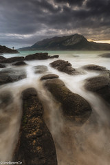 Tu el anzuelo y yo el sedal (IrreBerenTe Natalia Aguado) Tags: sea sunrise sonabia cantabria seascape landscape nature clouds fisherman fish irreberente longexposure travel spain canon nd water rocks oneperson factorhumano humanfactor nataliaaguadoirreberente