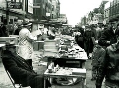 Maxwell Street - Chicago (Cragin Spring) Tags: midwest unitedstates usa unitedstatesofamerica urban city fleamarket tables people bw monochrome 1930s vintage photograph oldphotograph vendors southside southloop building canadianace gabels pepsi coke vienna sign shopping street maxwellstreet forgottenchicago blackwhite chicago chicagoillinois chicagoil illinois il chitown