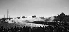 Epiphany Day celebrations (jimiliop) Tags: newyear celebrations kiato greece traditions bw blackandwhite holiday sea church tradition smoke boats crowd people waters
