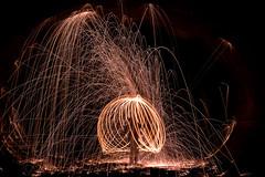Caging the Demon (Prestidigitizer) Tags: onblack sunshinecoast steelwool burning fire sparks tunnel pentaxk3 pentaxda50135mm longexposure le