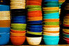 Phnom Penh 2017 Full_DSC4791 (BryonLippincott) Tags: cambodia cambodian phnompenh market bowls stacked textured multiplecolors shop crookedstack uneven orange greenblue black shopping brightcolor