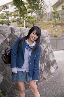 Portrait of high school girl at school entrance