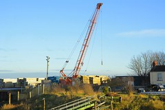The old orange crane in the timber yard (panmanstan) Tags: crane harbour haven barrow lincolnshire