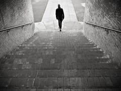 Lonely Hiking (saxild) Tags: olympus pen pl5 mzuiko 17mm18 digital bw black white sepia tint man walk stairway vignette symmetric cph bispebjerg denmark