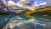 Solitude (Simon__X) Tags: sun morning mountain glacier light sunrise canoe red water lake emerald clouds fog
