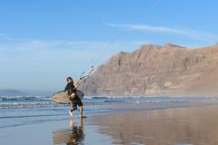 Taming the wind (NoloGZ) Tags: famara kitesurf sea wind beach water reflect