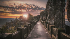 Basteibrücke (SecureTheMoment) Tags: elbsandsteingebirge sächsischeschweiz saxonswitzerland basteibrücke steinbrücke sunrise landscape sky sunnymorning stone rathen lohmen elbe felsen felsbrücke dunst haze fog