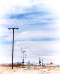 Holiness of Silence (Maureen Bond) Tags: maureenbond ca vintage desert poles wires tracks railroad clouds sky dirtroad pov wentexploringthismorning silence mojaveca