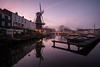 Neighbourhood Watch (McQuaide Photography) Tags: haarlem noordholland northholland netherlands nederland holland dutch europe sony a7rii ilce7rm2 alpha mirrorless 1635mm sonyzeiss zeiss variotessar fullframe mcquaidephotography lightroom adobe photoshop tripod manfrotto stad city urban waterside lowlight sunset zonsondergang mist mistig misty outdoor outside building longexposure sky water reflection river spaarne rivier atmosphere atmospheric calm tranquil peaceful winter cold koud serene wideangle groothoek windmill mill molen molendeadriaan adriaan traditional authentic scheepmakerskwartier
