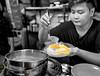 Mango sticky rice (lthrex) Tags: mango sticky rice thailand bangkok yellow filter black white bnw sel28f20 sony street