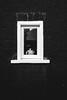 tea pot in window (garethottywill) Tags: teapot simple stark blackenedwhite brick texture glass frame refelction fuji fujifilm xt2 fujinon23mmf2