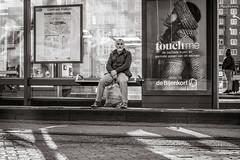 waiting (Gerard Koopen) Tags: nederland netherlands amsterdam capital city waiting tram man people bijenkorf touchme bw blackandwhite blackandwhiteonly straat street straatfotografie streetphotography fujifilm fuji xpro2 2017 gerardkoopen