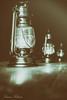 Lanterns on a mid winters night (Lauren Taliana) Tags: wealdanddownlandmuseum wealdanddownland historical retro sepia blackwhite blackandwhite bw oillamp gaslamp nightlight winter lanterns mono dark night table lights light lantern nikon nikkor flickr elements