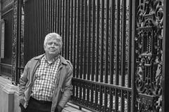 Waiting (photos_by_Henna) Tags: canon monochrome blackandwhite bw portrait fence iron leaning waiting ny vacation travel