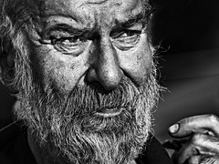 Out from the shadows (Ales Dusa) Tags: face streetportrait streetshot monochrome bw blackandwhite man beardedman oldman beard hand strongcontrast closeupportrait candid human humanity people canon5d ef70300mmf456lisusm alesdusa
