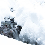 stream flowing in winter thumbnail