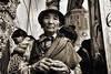 Kathmandu (paola ambrosecchia) Tags: bnw portrait blackandwhite ritratto nepal light face amazing eyes woman kathmandu street hat people fujifilm cappello art fineart bw