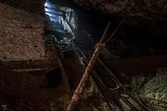 Shine from the machine room (miroslav_benak) Tags: mine mines mining industrial heritage abandoned underground trip dark darkness low light deep stone stairs space speleophotography descent slovakia terra banensium rails rust