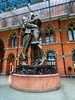 Close Encounters (Steve Taylor (Photography)) Tags: grandterrace paulday railway stpancras station statue thelovers themeetingplace art sculpture bronze metal brick glass man lady woman uk gb england greatbritain unitedkingdom london perspective reflection