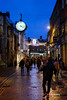 York Shopping (Paul Melling Photography) Tags: night england winter shopping street people city clock evening dusk lights illuminated road yorkshire dark shoppers stores shops uk streetlight york wetpavement