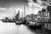 Hoorn (DST-photography) Tags: hoorn walk bw black white monochrome dramatic hdr sigma 1750mm nikon d7100 city centre christmas westfriesland lowlands netherlands holland amsterdam clouds weather toren tower hoofdtoren port haven boat people tree sky road building park architecture wheel bike