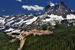 Peaks, Spires and a Ridgeline Covered with Snow (thor_mark ) Tags: azimuth184 bluelakepeak blueskies bluesskieswithclouds canvas capturenx2edited cascaderange colorefexpro concordtower cornicepeak curveinhighway curveinroad day8 drivetowashingtonpassoverlook earlywinterspire earlywinterspires evergreentrees evergreens hdr hillsideoftrees incamerahdr landscape lexingtontower libertybellmountain lookingsouth methowmountains mountainpeak mountains mountainsindistance mountainsoffindistance mountainside nature nikond800e northcascades northcascadesnationalparkservicecomplex okanogannationalforest okanoganwenatcheenationalforest outside pacificranges partlycloudy picapeak portfolio project365 ridgeline singleimagehdr snowonfaroffmountainpeaks snowcapped southearlywinterspire southwashingtonpass sunny talltrees theminuteman trees triptonorthcascadesandwashington washingtonpass washingtonpassobservationsite washingtonpassoverlook okanoganwenatcheenationalfore washington unitedstates
