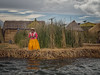Yellow (Mariasme) Tags: island reed woman skirt yellow lagotiticaca peru uros