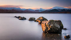 Milarrochy Bay Rocks (roseysnapper) Tags: loch lomond milarrochy bay nikkor 2470 f28 nikon d810 circular polarizer long exposure nd10 scotland trossachs calm cloud mountain outdoor rocks sky snow sunset tranquil water landscape rock