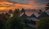 Sunset in paradise (Marion McM) Tags: sunset coast island moorea palmtrees trees thatch sky thatchedhouses clouds red orange landscape papeete tahiti ocean pacificocean paradise canoneosm6
