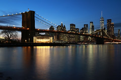 Brooklyn Bridge (erichudson78) Tags: usa nyc brooklynbridge eastriver longexposure poselongue river eau water reflection reflets canoneos6d canonef24105mmf4lisusm pont bridge skyscraper gratteciel ciel sky skyline crépuscule dusk ville town fleuve blue bleu 7dwf twilight wideangle grandangle financialdistrict newyorkcity bluehour heurebleue lumières lights oneworldtradecenter urbanreflection refletsurbains janvier january building winter hiver architecture pontsuspendu suspensionbridge cityscape tower tour manège funfair dumbo brooklyn paysageurbain urbanlandscape flickrelite mondayblues