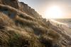 Rotes Kliff (andreas.zachmann) Tags: deu sand winter sonne himmel wellen nordsee abendstimmung dünen personen strand kliff meer wasser brandung landschaft dünengras kampen schleswigholstein deutschland