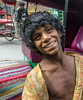 colorful smile (Pejasar) Tags: beggar dalit caste oppressed poverty poor child dirty clothes foot ragged smile appreciation joy momentary happiness portrait colorful teeth boy olddelhi india candid street