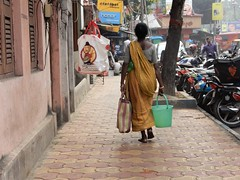 .... bag and bucket ... (@ Images and Pictures) Tags: bag bucket bagandbucket woman sidewalk pavement street bikes buildings streetphotography streetsofkolkata