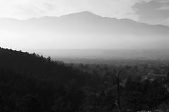 Pikes Peak Through The Haze (rolandmks7) Tags: sonynex5n makinon 50mm f19 pikespeak blackandwhite coloradosprings colorado
