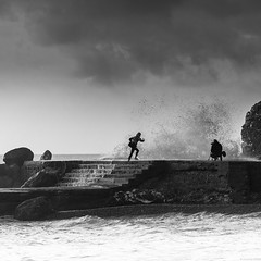 run baby run... (andreasbrink) Tags: italy landscape people winter bw camogli sea wave fccmotion