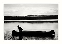 let's go (stefkas) Tags: stefkas monochrome blackandwhite blackshadows almostabstract sweden lake boat canoe boy vscox
