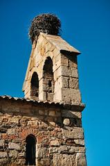 Romanesque cathedral of Idanha-a-Velha with a stork's nest on top (Gail at Large | Image Legacy) Tags: 2017 idanhaavelha portugal romanesquebasilica church gailatlargecom storksnest