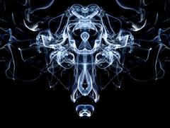 Face In Smoke (craig_schenk) Tags: winner alt blue white art light new smoke studio abstract abstractart figue fineart graphicelements ink inkblot rorschach face mask creature creative canada stilllife texture pattern
