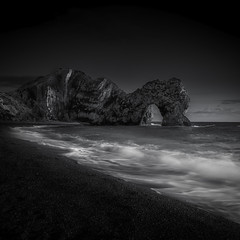 The Thirsty Dragon (Rich Walker75) Tags: dorset durdledoor landscape landscapes landscapephotography landmark landmarks beach beaches sea ocean sand water longexposure longexposurephotography greatbritain england canon eos100d efs1585mmisusm eos seascape seascapes mono black white monochrome blackandwhite