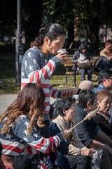 Street food in Ueno park, Tokyo - Japan (Marconerix) Tags: ragazzo ragazza boy girl usa streetfood food cibo pesce spiedino parco ueno japan giappone tokyo outdoor allaperto capellilunghi longhair