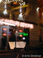 Karlin @ Casablanca #3 (Ario Omidvar Photographz) Tags: citycenter city urban vienna wien bermudadreieck reflection glass music musician musiker nightlife bar club guitar singersongwriter christmas weihnachten