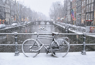 Swirling snow on a windy wintry day in old Amsterdam