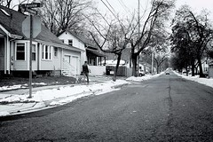 Down The Road 647 (Dimi Sahn) Tags: man dog street candid landscape urban car pavement homes houses trees black white canon fd 28mm f28 driving flickrfriday outofthebox