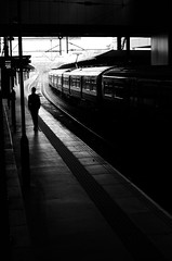 Detached commuter lingers (Joehii) Tags: alone lonely detached quiet train station platform spring commuter commuting rushhour business working avoiding black white waiting patient isolated home work travel leeds england journey avoid