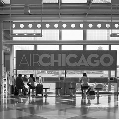 Travel by Air Chicago (Dennis M Chua) Tags: 120film blackandwhite mediumformat foldercamera 6x6 zeiss superikonta 53316 kodak tmy400 epson v600 streetphotography airport usa illinois chicago 8028zeisstessar istillshootfilm believeinfilm filmphotography vintagecamera superikontabx