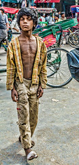 boy of Old Delhi (Pejasar) Tags: beggar dalit caste oppressed poverty poor child dirty clothes barefoot wounded foot ragged momentary portrait streetcandid olddelhi india aloof boy alone crowd thin