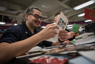 A Sailor reads a holiday card aboard USS Theodore Roosevelt.