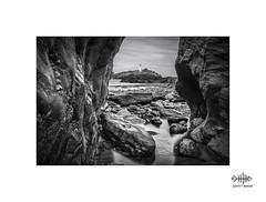 Between a rock and a hard place (silver/halide) Tags: johnbaker mono monochrome blackandwhite bw longexposure lowtide godrevy godrevylighthouse cornwall rocks rockpool atlantic atlanticocean godrevyisland seashore