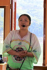 Our Guide on the Goddess Stream (oxfordblues84) Tags: peoplesrepublicofchina china oat overseasadventuretravel victoriacruises victoriajenna victoriajennacruise yangtzerivercruise yangtzeriver rivercruise riverboatcruise goddessstream wushangodesssceniczone threegorges boat guide woman chinese chineseguide chinesewoman chinesetourguide gorge