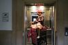 Untitled (Guille Ibanez) Tags: woman lift bolton elevator onwheels pushchair shoppingtrolley whatsthetime fujifilm fuji xt2 decisivemoment buildinglift